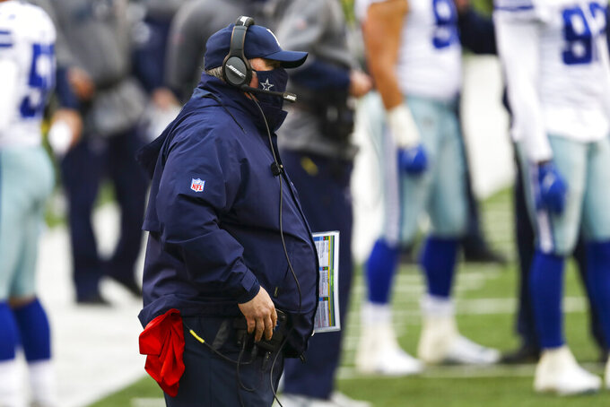 Dallas Cowboys head coach Mike McCarthy on the sideline in the first half of an NFL football game against the Cincinnati Bengals in Cincinnati, Sunday, Dec. 13, 2020. (AP Photo/Aaron Doster)