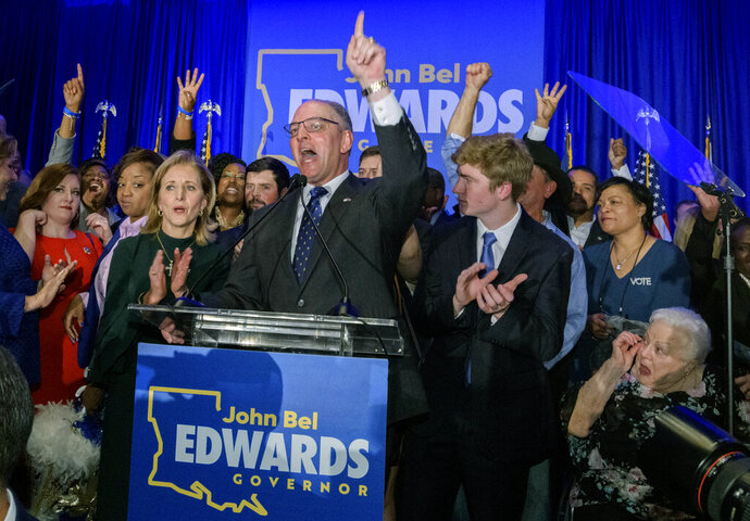 FILE - In this Saturday, Nov. 16, 2019 file photo, Louisiana Gov. John Bel Edwards arrives to address supporters at his election night watch party in Baton Rouge, La. A re-election victory by Edwards has assured Democrats of an all-important place at the table when political maps are redrawn after the 2020 census for future elections to Congress and the state legislature. Edwards' narrow triumph on Saturday marked the third significant win in a Southern state in two weeks for Democrats, following their takeover of the Virginia General Assembly and the defeat of Republican Kentucky Gov. Matt Bevin by Democratic Attorney General Andy Beshear.   (AP Photo/Matthew Hinton, File)