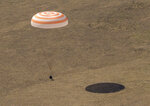 The Soyuz MS-17 spacecraft lands in a remote area near the town of Zhezkazgan, Kazakhstan, Saturday, April 17, 2021, with Expedition 64 crew members Kate Rubins of NASA, Sergey Ryzhikov and Sergey Kud-Sverchkov of Roscosmos. Rubins, Ryzhikov and Kud-Sverchkov returned after 185 days in space having served as Expedition 63-64 crew members onboard the International Space Station. (Bill Ingalls/NASA via AP)