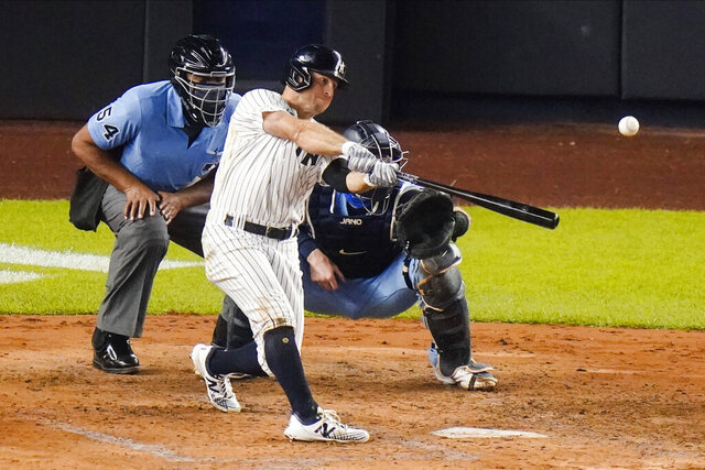 New York Yankees' Brett Gardner hits a two-run home run during the fourth inning of the team's baseball game against the Toronto Blue Jays on Thursday, Sept. 17, 2020, in New York. (AP Photo/Frank Franklin II)