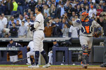 New York Yankees' Aaron Judge, left, reacts after striking out with two men on base to end the second inning against the Houston Astros during Game 3 of baseball's American League Championship Series, Tuesday, Oct. 15, 2019, in New York. (AP Photo/Frank Franklin II)