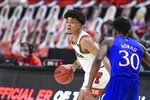 Texas Tech's Micah Peavy (5) attempts to pass the ball during the first half of an NCAA college basketball game against Kansas in Lubbock, Texas, Thursday, Dec. 17, 2020. (AP Photo/Justin Rex)