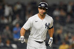 New York Yankees' Giancarlo Stanton gestures to teammates as he runs the bases after hitting a home run during the third inning of a baseball game against the Texas Rangers Tuesday, Sept. 21, 2021, in New York. (AP Photo/Frank Franklin II)