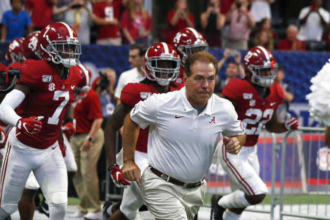 FILE - In this Aug. 31, 2019, file photo, Alabama head coach Nick Saban leads his team onto the field for a an NCAA college football game against Duke, in Atlanta. For the first time in college football history, there will be two games matching teams of at least 8-0 on the same day, according to ESPN Facts and Info. In Tuscaloosa, Alabama, LSU and the Crimson Tide will play the first regular-season game matching AP Nos. 1 and 2 since 2011 _ when No. 1 LSU beat No. 2 Alabama 9-6 in overtime. (AP Photo/John Bazemore, File)