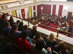 Parents, teachers and others pack an upper gallery to listen to a public hearing on complex education legislation Monday, Feb. 11, 2019, in the House of Delegates chambers in Charleston, W.Va. Dozens of speakers crammed the first of two public hearings Monday to speak against a complex education bill in West Virginia that teachers' unions claim is retaliation for a nine-day strike last year. (AP Photo/John Raby)