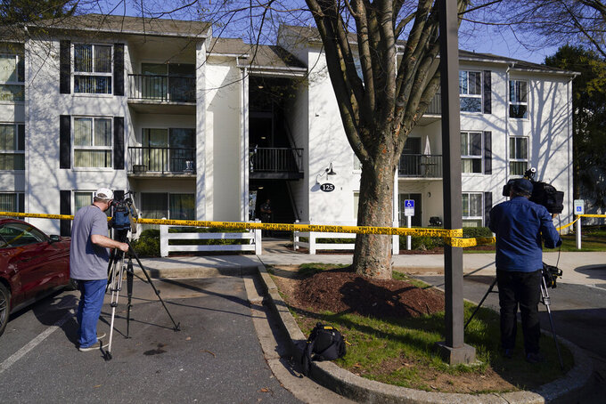 Television crew film outside the apartment of Navy Petty Ofc. 3rd Class Fantahun Girma Woldesenbet, assigned to Fort Detrick in Frederick, Md., Tuesday, April 6, 2021. Authorities say the Navy medic shot and wounded two U.S. sailors at a military facility before fleeing to a nearby Army base where security forces shot and killed him. (AP Photo/Carolyn Kaster)