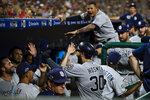 San Diego Padres' Eric Hosmer celebrates with teammates after scoring off Ty France's single during the fifth inning of a baseball game against the Philadelphia Phillies, Saturday, Aug. 17, 2019, in Philadelphia. (AP Photo/Matt Rourke)