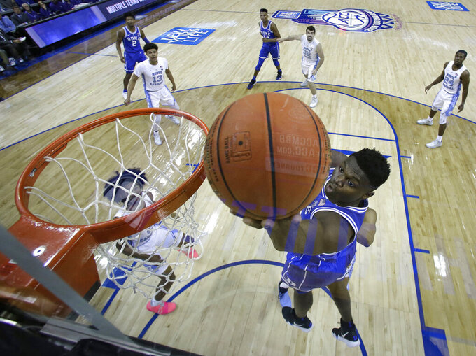 Duke's Zion Williamson drives to the basket against North Carolina during the second half of an NCAA college basketball game in the Atlantic Coast Conference tournament in Charlotte, N.C., Saturday, March 16, 2019. (AP Photo/Chuck Burton)