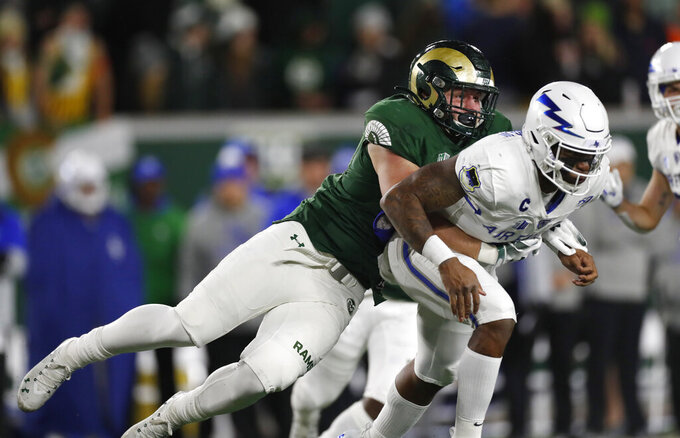 Colorado State defensive lineman Jan-Phillip Bombek, left, tackles Air Force quarterback Donald Hammond III after he threw the ball in the first half of an NCAA football game Saturday, Nov. 16, 2019 in Fort Collins, Colo. (AP Photo/David Zalubowski)
