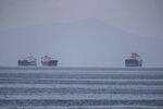 Anchored ships are seen miles away from the port of Piraeus, near Athens, Greece, Tuesday, May 26, 2020. During the new coronavirus pandemic, about 150,000 seafarers are stranded at sea in need of crew changes, according to the International Chamber of Shipping. Roughly another 150,000 are stuck on shore, waiting to get back to work. (AP Photo/Petros Giannakouris)