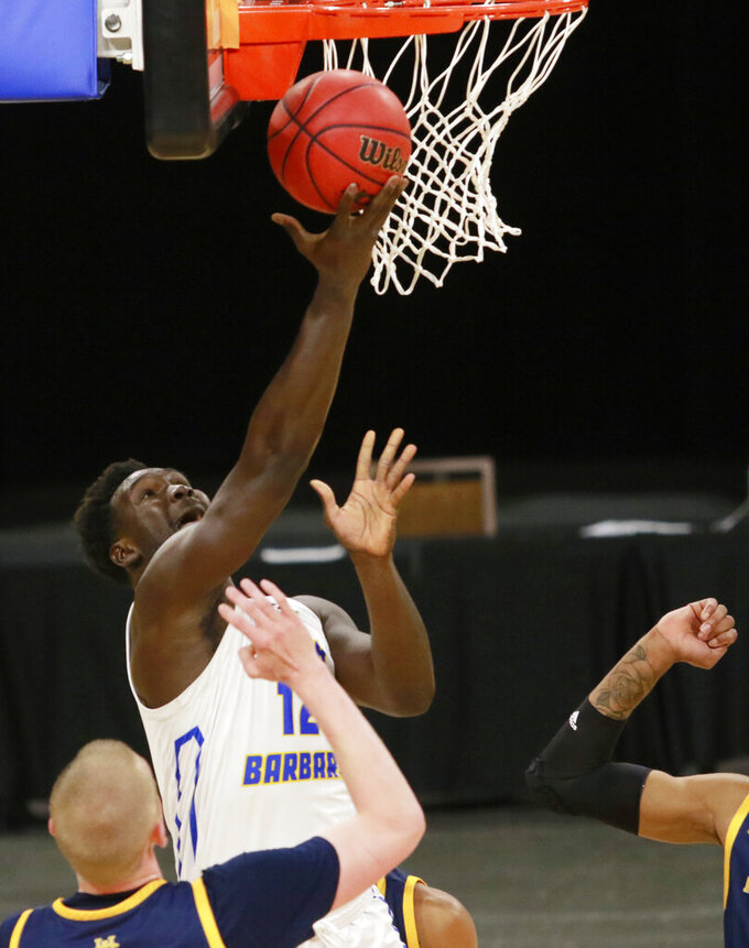 UC Santa Barbara's Amadou Sow (12) shoots during the second half of the team's NCAA college basketball game against UC Irvine for the championship of the Big West Conference men's tournament Saturday, March 13, 2021, in Las Vegas. (AP Photo/Ronda Churchill)