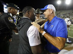 Middle Tennessee head coach Rick Stockstill, right, congratulates Vanderbilt head coach Derek Mason after an NCAA college football game Saturday, Sept. 1, 2018, in Nashville, Tenn. Vanderbilt won 35-7. (AP Photo/Mark Humphrey)