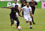 Inter Miami midfielder Rodolfo Pizarro (10) looks for running room as Atlanta United defender George Bello (21) defends on the play during the first half of an MLS soccer match, Sunday, May 9, 2021, in Fort Lauderdale, Fla. (AP Photo/Jim Rassol)