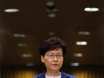 Hong Kong Chief Executive Carrie Lam listens to questions during a press conference in Hong Kong, Tuesday, July 9, 2019. Lam said Tuesday the effort to amend an extradition bill was dead, but it wasn't clear if the legislation was being withdrawn as protesters have demanded. (AP Photo/Vincent Yu)