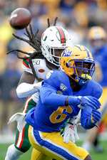 Miami defensive back Robert Knowles, left, breaks up a pass to Pittsburgh wide receiver Aaron Mathews (6) during the first half of an NCAA college football game, Saturday, Oct. 26, 2019, in Pittsburgh. (AP Photo/Keith Srakocic)