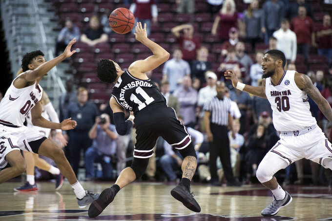 Mississippi State guard Quinndary Weatherspoon (11) loses the ball under pressure from South Carolina's A.J. Lawson (00) and Chris Silva (30) during the second half of an NCAA college basketball game Tuesday, Jan. 8, 2019, in Columbia, S.C. South Carolina won 87-82. (AP Photo/Sean Rayford)