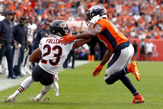 Chicago Bears cornerback Kyle Fuller (23) intercepts a pass intended for Denver Broncos wide receiver Emmanuel Sanders (10) during the second half of an NFL football game, Sunday, Sept. 15, 2019, in Denver. (AP Photo/David Zalubowski)