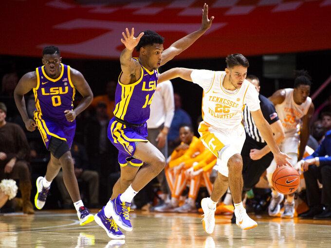 Tennessee guard Santiago Vescovi (25) drives past LSU guard Marlon Taylor (14) during an NCAA college basketball game at Thompson-Boling Arena, Saturday, Jan. 4, 2020,  Knoxville, Tenn. (Brianna Paciorka//Knoxville News Sentinel via AP)