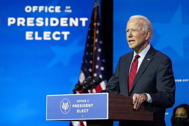 President-elect Joe Biden speaks during an event at The Queen theater in Wilmington, Del., Tuesday, Dec. 8, 2020, to announce his health care team. Vice President-elect Kamala Harris listens at right. (AP Photo/Susan Walsh)