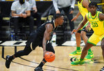 Colorado guard McKinley Wright IV, left, drives to the basket as Oregon forward Eric Williams Jr. defends in the first half of an NCAA college basketball game Thursday, Jan. 7, 2021, in Boulder, Colo. (AP Photo/David Zalubowski)