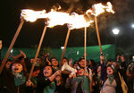 Women hold torches after lawmakers failed to pass a law that decriminalizes abortion in cases of rape, outside the National Assembly in Quito, Ecuador, Tuesday, Sept. 17, 2019 (AP Photo/Dolores Ochoa)