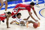 Mississippi's Devontae Shuler (2) dives over LSU's Eric Gaines, bottom, as they battle for a loose ball in the first half of an NCAA college basketball game in the Southeastern Conference Tournament Friday, March 12, 2021, in Nashville, Tenn. (AP Photo/Mark Humphrey)