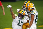 Green Bay Packers wide receiver Allen Lazard (13) reacts after a 72 year pass completion setting up a touchdown in the second half of an NFL football game against the New Orleans Saints in New Orleans, Sunday, Sept. 27, 2020. (AP Photo/Butch Dill)
