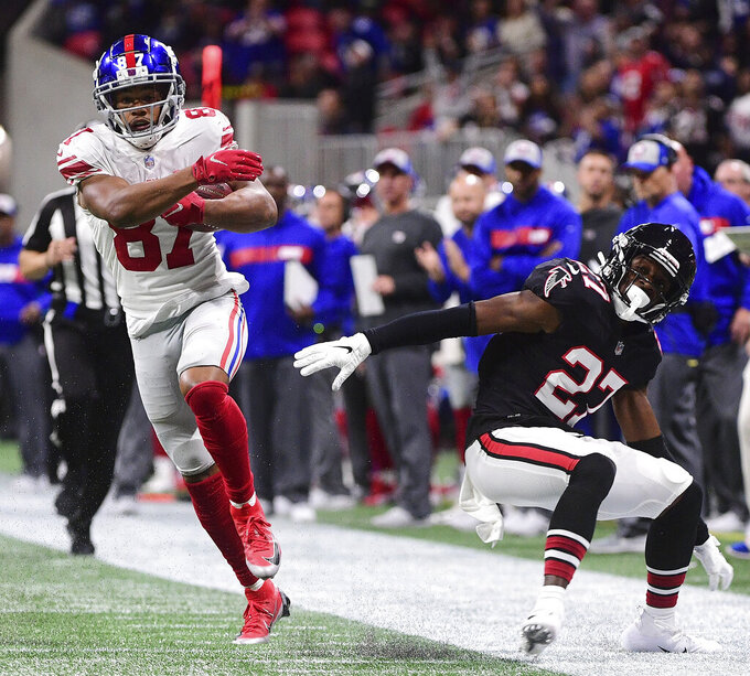 FILE - In this Oct. 22, 2018, file photo, New York Giants wide receiver Sterling Shepard (87) jukes to get by Atlanta Falcons strong safety Damontae Kazee (27) during the second half of an NFL football game in Atlanta. Juke: When any player make a deceptive move to fake out an opponent on the field. Often, but not always, applies to running backs and wide receivers. (AP Photo/John Amis, File)