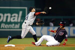 Miami Marlins shortstop Miguel Rojas, left, throws to first base for a double play after forcing out Washington Nationals' Yan Gomes, right, on Gerardo Parra's ground ball to end the seventh inning of a baseball game, Friday, May 24, 2019, in Washington. (AP Photo/Patrick Semansky)