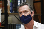 FILE - In this June 4, 2020, file photo, California Gov. Gavin Newsom wears a face mask during his stop at the Legendary Coffee and Books in Stockton, Calif. Gov. Newsom's administration on Thursday, June 18, 2020, mandated that Californians wear masks in most indoor settings as the state continues to battle the coronavirus. (AP Photo/Rich Pedroncelli, Pool, File)