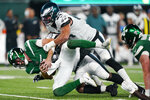 New York Jets quarterback James Morgan, below, is sacked by Philadelphia Eagles' Matt Leo (64) and T.Y. McGill during the second half of an NFL preseason football game Friday, Aug. 27, 2021, in East Rutherford, N.J. (AP Photo/John Minchillo)
