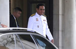 Thailand's Prime Minister Prayuth Chan-ocha leaves from the government house in Bangkok Tuesday, July 16, 2019. Prayuth is preparing to lead his 36 cabinet members to take their oath in front of Thailand's King Maha Vajiralongkorn. (AP Photo/Sakchai Lalit)
