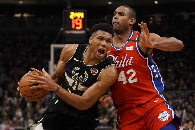 Milwaukee Bucks' Giannis Antetokounmpo drives past Philadelphia 76ers' Al Horford during the second half of an NBA basketball game Thursday, Feb. 6, 2020, in Milwaukee. The Bucks won 112-101. (AP Photo/Morry Gash)