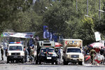 Ambulances are parked at the site of a suicide attack near the U.S. Embassy in Kabul, Afghanistan, Tuesday, Sept. 17, 2019. Hours earlier Afghan officials said a suicide bomber rammed his motorcycle packed with explosives into the entrance to a campaign rally of President Ashraf Ghani in northern Parwan province, killing over 20 people and wounding over 30. Ghani was present at the venue but was unharmed. The Taliban have claimed both attacks. (AP Photo/Ebrahim Noroozi)