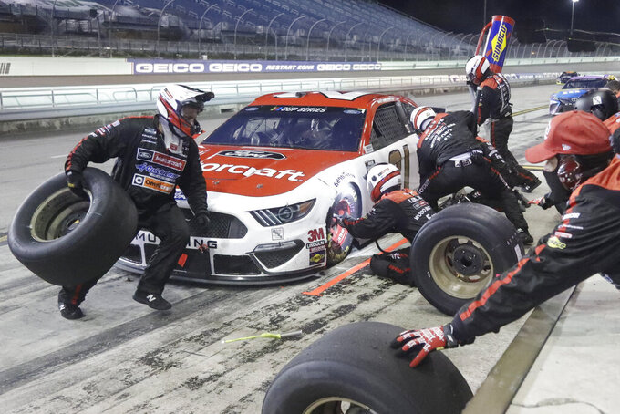 Matt DiBenedetto makes a pit stop during a NASCAR Cup Series auto race Sunday, June 14, 2020, in Homestead, Fla. (AP Photo/Wilfredo Lee)