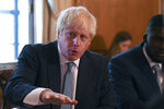 Britain's Prime Minister Boris Johnson speaks during a roundtable to improve the criminal justice system, at 10 Downing Street in London, Monday, Aug. 12, 2019. (Daniel Leal-Olivas/Pool Photo via AP)