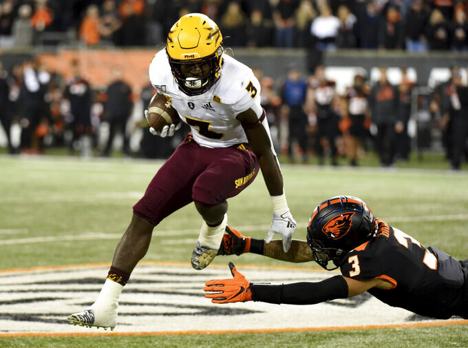 Arizona State running back Eno Benjamin, left, avoids a tackle by Oregon State defensive back Jaydon Grant during the second half of an NCAA college football game in Corvallis, Ore., Saturday, Nov. 16, 2019. (AP Photo/Steve Dykes)