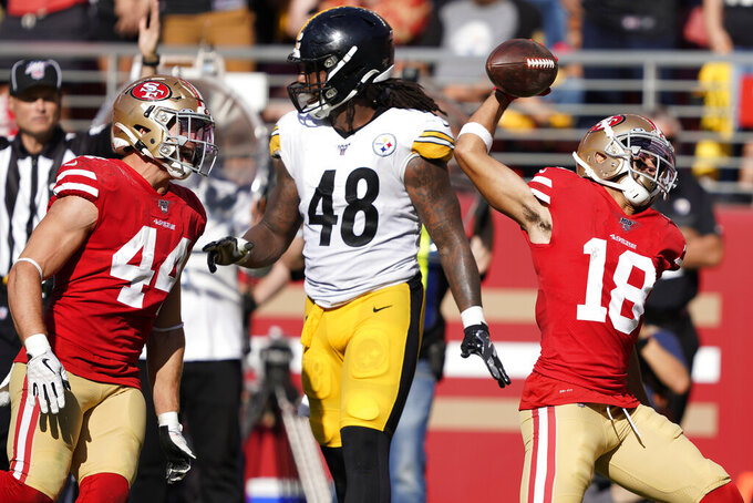 San Francisco 49ers wide receiver Dante Pettis (18) celebrates after scoring against the Pittsburgh Steelers during the second half of an NFL football game in Santa Clara, Calif., Sunday, Sept. 22, 2019. (AP Photo/Tony Avelar)