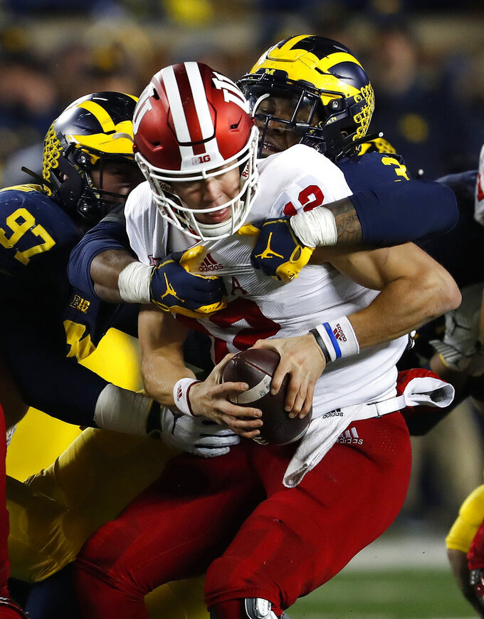 Indiana quarterback Peyton Ramsey (12) is sacked by Michigan defensive lineman Rashan Gary (3) in the second half of an NCAA college football game in Ann Arbor, Mich., Saturday, Nov. 17, 2018. (AP Photo/Paul Sancya)