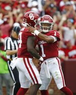FILE - In this Saturday, Sept. 8, 2018, file photo, Oklahoma quarterback Kyler Murray (1) celebrates a touchdown with teammate Trey Sermon (4) in the first half of an NCAA college football game against UCLA in Norman, Okla. The pressure on Murray just increased now that running back Rodney Anderson is out for the season. (AP Photo/Sue Ogrocki, File)