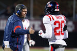 "In this Nov. 28, 2019 photo, Mississippi head coach Matt Luke reaches out to Mississippi defensive back Keidron Smith (20) following a second half play during an NCAA college football game against Mississippi State, in Starkville, Miss. Mississippi has fired Luke, three days after his third non-winning season ended with an excruciating rivalry game loss. Athletic director Keith Carter said Sunday, Dec. 1, 2019 the decision to change coaches was made after evaluating the trajectory of the program and not seeing enough ""momentum on the field. (AP Photo/Rogelio V. Solis)"
