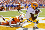 Pittsburgh wide receiver Melquise Stovall (4) catches a touchdown pass in front of Tennessee defensive back Theo Jackson (26) during the first half of an NCAA college football game Saturday, Sept. 11, 2021, in Knoxville, Tenn. (AP Photo/Wade Payne)