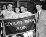 FILE - In this Dec. 12, 1954, file photo, Cleveland Browns, from left, Pete Brewster, Lou Groza, Chuck Noll, Otto Graham and coach Paul Brown pose in the dressing room after defeating the Pittsburgh Steelers to win the East divisional championship. The Cleveland Browns won the NFL title in their first year in the league (1950) and added championships in 1954-55. (AP Photo/Julian C. Wilson, File)