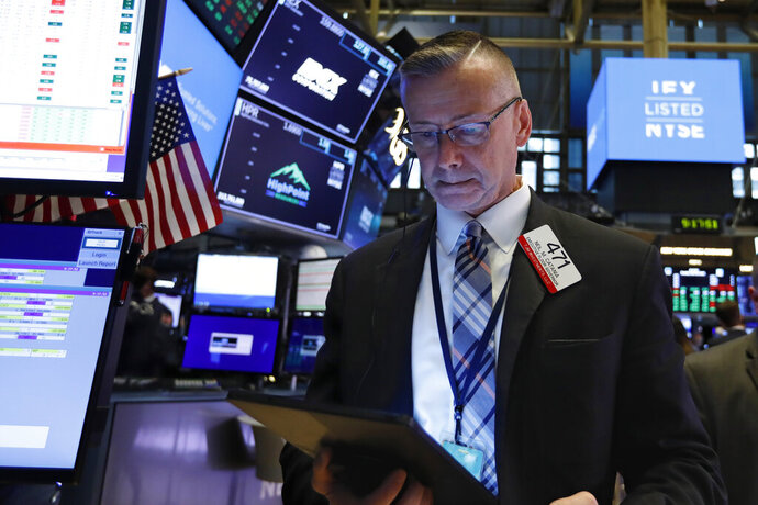 Trader Neil Catania works on the floor of the New York Stock Exchange, Tuesday, June 18, 2019. Stocks are opening higher on Wall Street following big gains in Europe after the head of the European Central Bank said it was ready to cut interest rates and provide more economic stimulus if necessary. (AP Photo/Richard Drew)