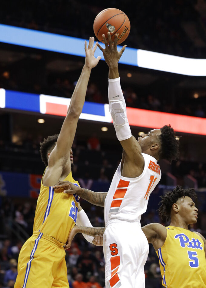 Syracuse's Oshae Brissett (11) shoots against Pittsburgh's Terrell Brown (21) during the first half of an NCAA college basketball game in the Atlantic Coast Conference tournament in Charlotte, N.C., Wednesday, March 13, 2019. (AP Photo/Chuck Burton)