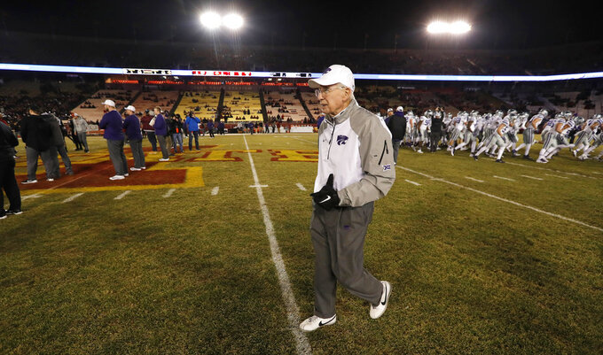 Kansas State head coach Bill Snyder walks on the field before an NCAA college football game against Iowa State, Saturday, Nov. 24, 2018, in Ames, Iowa. (AP Photo/Charlie Neibergall)