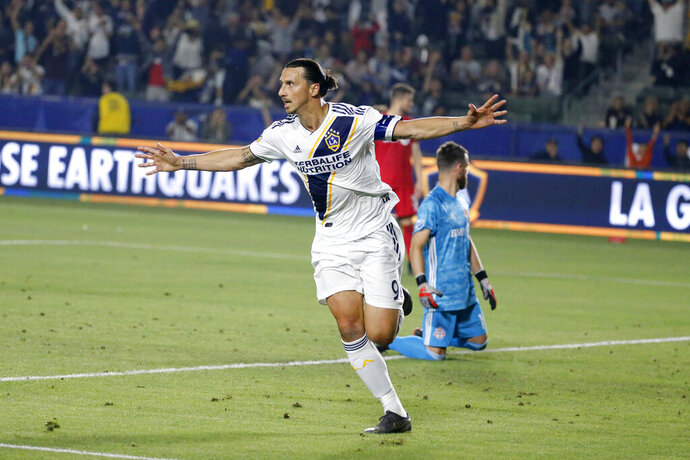 FILE - In this July 4, 2019, file photo, LA Galaxy forward Zlatan Ibrahimovic (9) celebrates scoring a goal during the second half of the team's MLS soccer match against Toronto FC in Carson, Calif. (AP Photo/Ringo H.W. Chiu, File)