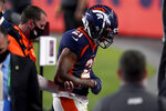 Denver Broncos cornerback A.J. Bouye (21) leaves the game with an injury during the first half of an NFL football game against the Tennessee Titans, Monday, Sept. 14, 2020, in Denver. (AP Photo/Jack Dempsey)
