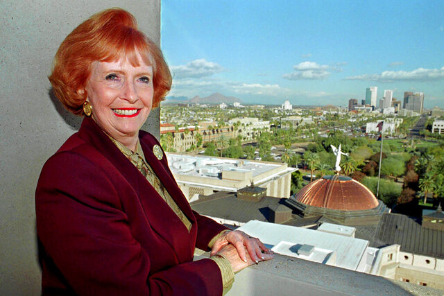 "FILE - In this Dec. 9, 1997 file photo, Arizona Gov. Jane Hull, nearing her 100th day in office, poses from a state capitol balcony which overlooks Phoenix. Hull, the first woman elected governor of Arizona and the state's first female House speaker, has died. She was 84. Gov. Doug Ducey announced her death on Friday, April 17, 2020 saying, ""Governor Hull dedicated 25 years to principled public service."" (AP Photo/Nancy Engebretson, file)"