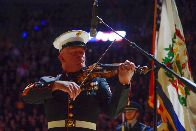 "Master Gunnery Sergeant Peter Wilson of ""The President's Own"" United States Marine Band performs the national anthem on his violin before an NCAA college basketball game in Morgantown, W.Va. on Saturday Feb. 9, 2019. (AP Photo/Craig Hudson)"